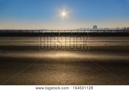 A Deserted Car Bridge In The Rays Of The Rising Sun At Dawn
