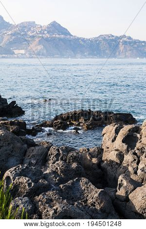 Rocks On Coast Of Ionian Sea In Giardini Naxos