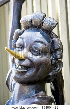 SAMARA, RUSSIA - JUNE 19, 2017: Museum-Estate of the writer A.N. Tolstoy. Bronze statue of Pinocchio. The face of Pinocchio and his long nose close up