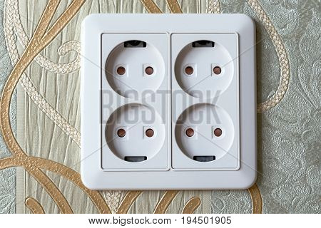electrical outlet on the four slots in the wall