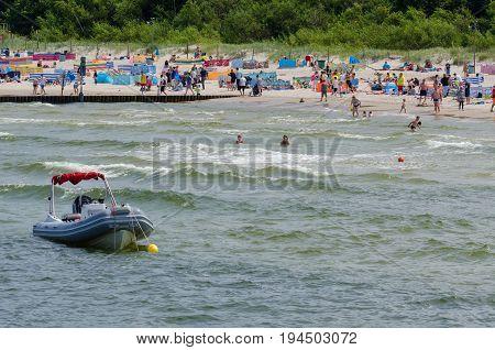 KOLOBRZEG, WEST POMERANIAN / POLAND - Vacationers on a sunny sea beach