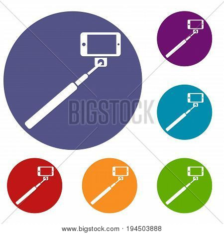 Selfie stick and smartphone icons set in flat circle reb, blue and green color for web