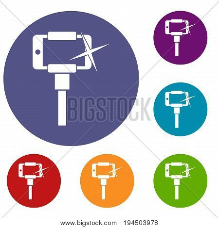 Taking pictures on smartphone on selfie stick icons set in flat circle reb, blue and green color for web