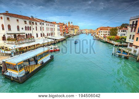 Spectacular medieval buildings narrow canals with restaurants hotels and boats in the best touristic town Venice Veneto region Italy Europe