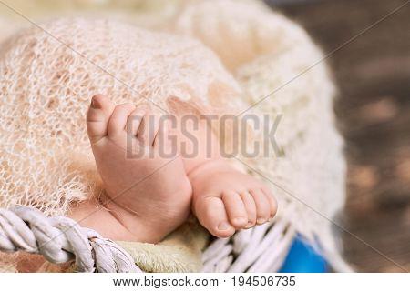 Feet of caucasian baby. Childish legs close up.