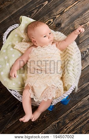 Infant pointing finger. Small child top view. Baby growth and development.