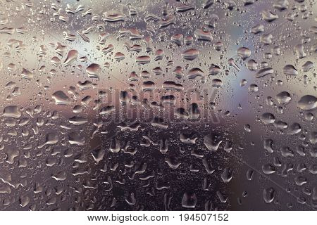 Texture of Transparent window glass wet from rain drops close-up