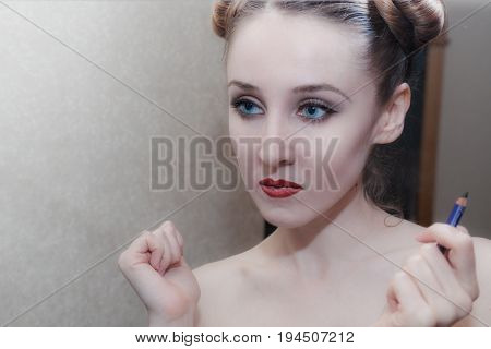 Portrait Of A Girl Applying Herself Makeup