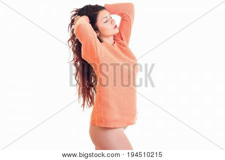 beautiful brunette woman in sweater with closed eyes isolated on white background