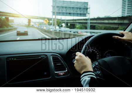 woman hands on wheal in the new car.
