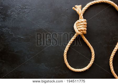 Running Knot Of Rope On A Black Background With Space For Text. Concept Stop Suicide