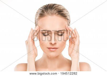 Mature female beauty health care studiio portrait headache