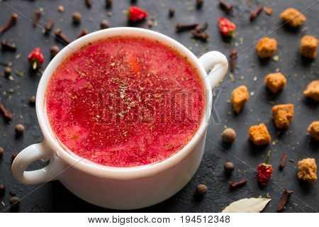 Borsch with herbs and spices close up