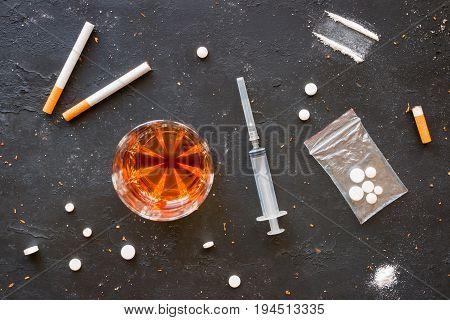 Alcohol, Cigarettes And Drugs On A Black Background
