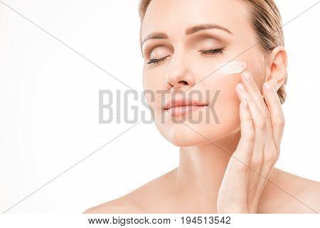 Mature female beauty health care studiio portrait cream