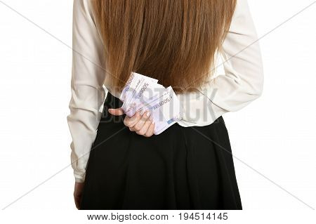 Beautiful woman with money behind her back on white background