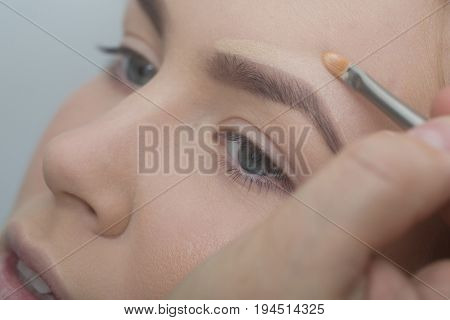 Girl Getting Foundation Cream On Face With Brush