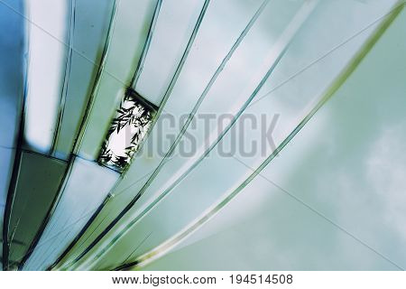 abstract background broken mirror shows blue turquoise sky colors and the reflection of willow leaves on one shard as in a window