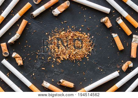 A Frame Of Cigarettes And Cigarette Butts And The Inscription