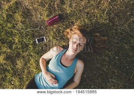 Relaxing Outdoor. Young Woman Relaxing In The Park After Running