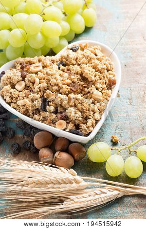 Healthy Granola Muesli Breakfast With Grape, Nuts And Wheat Ears, Love It Concept, In White Ceramic