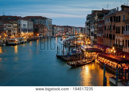 Grand Canal at night in Venice, Italy. Grand Canal is one of the major water-traffic corridors and tourist attraction in Venice.