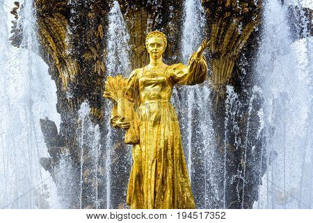 MOSCOW - JULY 29, 2016: Detail of the Peoples Friendship Fountain in All-Russia Exhibition Centre (VDNKh). It was built in the 50s. 16 golden sculptures represent republics of the Soviet Union.