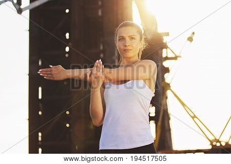 Confident Sportswoman. Portrait Of Beautiful Young Woman Keeping Concentrated And Looking Away While