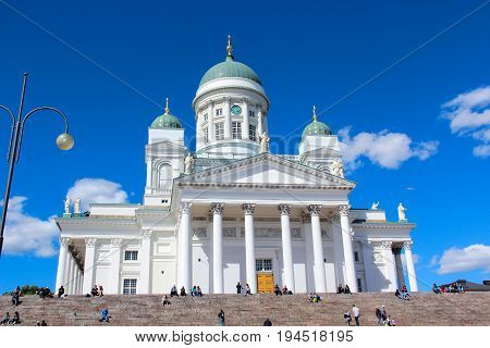 Helsinki, Finland - 28 Jun 2017: Cathedral. The facade with a large staircase with many steps.  Travel landmark. Summer sunny day. Blue sky.