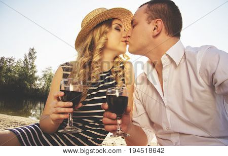 Love To Kiss Her Lips. Portrait Of Man In Casual Wear Kissing His Young Beautiful Woman In Dress And