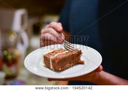 man with for eating carrot cake dessert