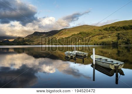 Stunning Dramatic Stormy Sky Formations Over Breathtaking Mountain Lake Landscape With Rowing Boats