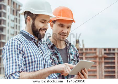 Male work building construction engineering occupation using digital device