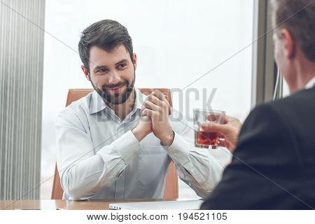 Young male consultation with agent purchase rent property real estate consultant offer alcohol
