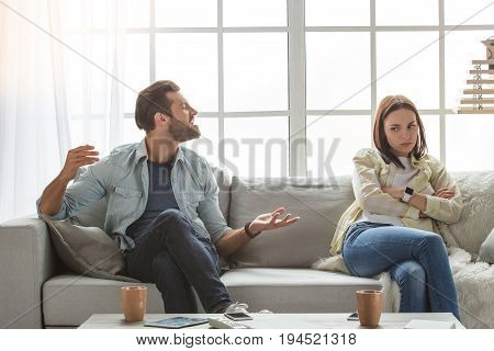 Young woman and man family couple indoors quarrel