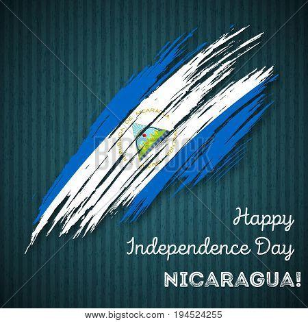 Nicaragua Independence Day Patriotic Design. Expressive Brush Stroke In National Flag Colors On Dark