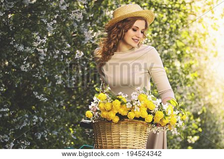 Perfect Beauty. Portrait Of Attractive Young Woman In Dress And Hat Keeping Eyes Closed And Looking