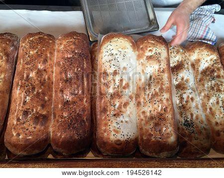 Baker Man Baking Warm Breads In A Bakery