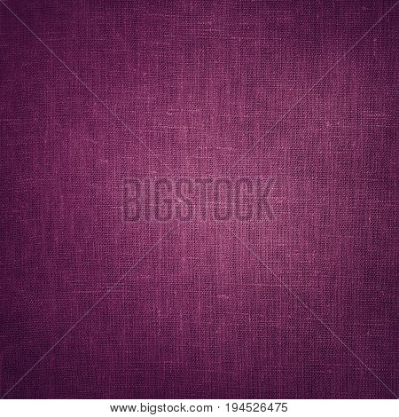 Coarse mauve Canvas Fabric Cloth Burlap Sack texture with darkened edges. Rough grunge background or wallpaper close up. Web banner Square Image