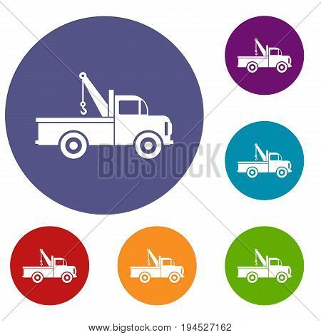 Car towing truck icons set in flat circle reb, blue and green color for web