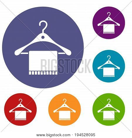 Scarf on coat hanger icons set in flat circle reb, blue and green color for web