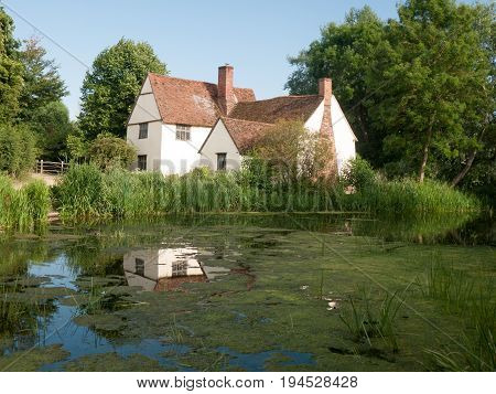 ' cottage and river front on a clear sunny day; Suffolk; UK