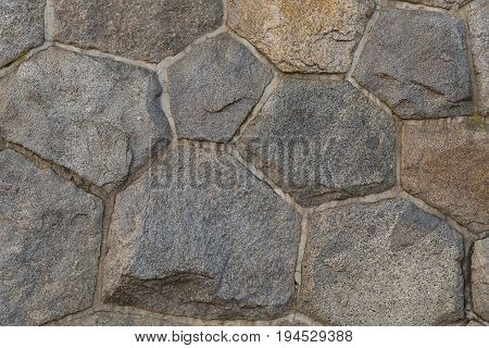 background base wall composed of hexagonal octagonal stones strong reliable light gray