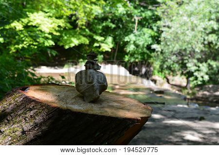 A cairn on top of a tree stump