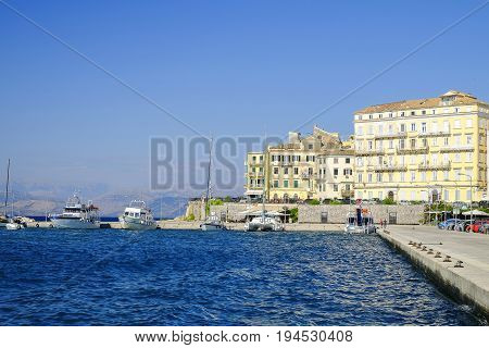 View on the old town of Kerkyra and old port with boats on the island Corfu Greece.