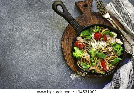 Whole Wheat Pasta With Chicken Fillet And Vegetables In A Cast Iron  Pan.top View With Space For Tex