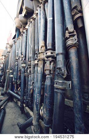 Row of car parts in junkyard