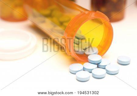 Spilt bottle of pills, close-up