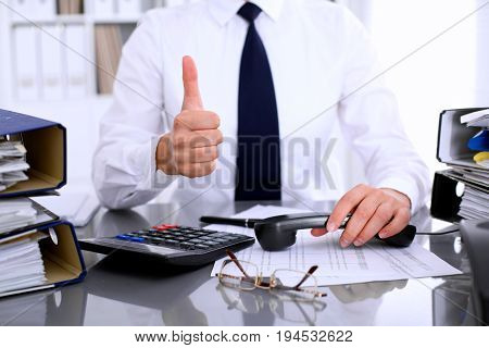 Revenue Service inspector is ready for helping and consulting clients. Audit concept.