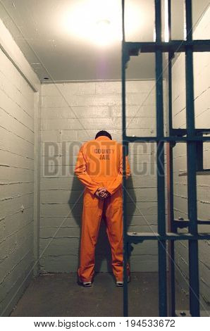 Prisoner standing against the wall
